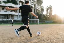 Man Kicking Penalty In Yard