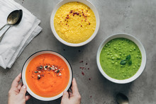 Woman Serving Gluten-free, Low-fat Vegetable Soups