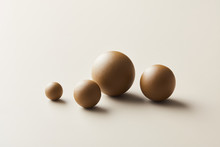 Light-brown Colored Spheres In Minimalist Layout