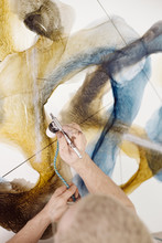 Creative Man With Airbrush Creating Painting