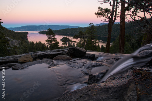 Spoed Fotobehang Bos rivier Calm evening and colorful sunset. View to the Tahoe Lake from Eagle Fall.