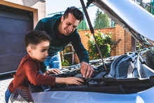 The Father And Son Repair A Car