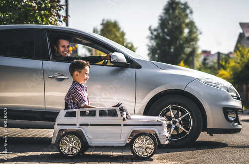 obraz PCV The father and son driving their cars