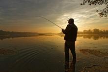 Fisherman Silhouette During Au...