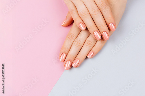 Beautiful Woman Hands. Spa and Manicure concept. Female hands with pink manicure. Soft skin, skincare concept. Beauty nails. over beige background.