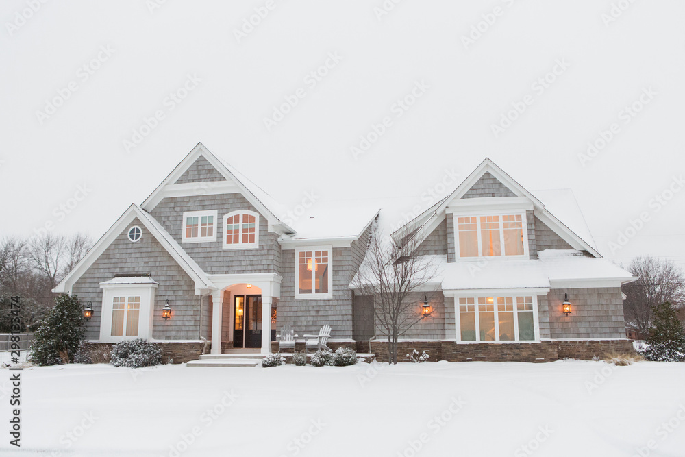 Fototapety, obrazy: Wood shingled home in snow with warm lights illuminating windows