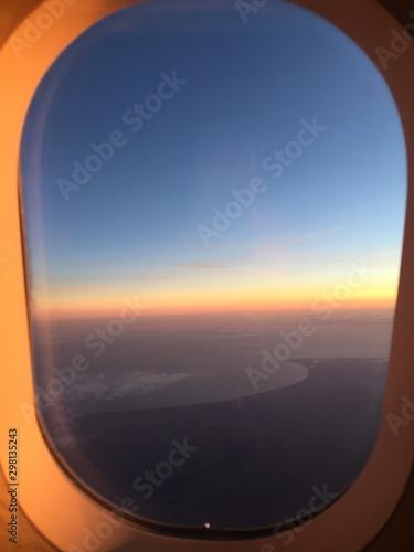 Photo Sonnenaufgang aus dem Flugzeug Fenster