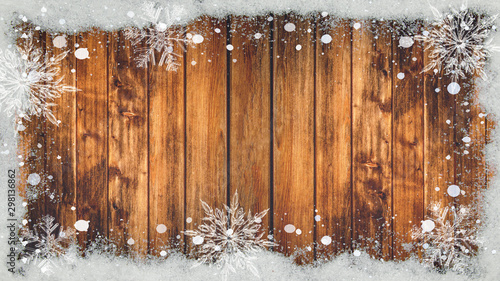 Tuinposter Metal winter Background - Frame made of snow with snowflakes and ice crystals on wooden texture, top view with space for text