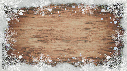 Obraz winter Background - Frame made of snow with snowflakes and ice crystals on wooden texture, top view with space for text - fototapety do salonu