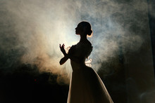 Ballerina In Dress Posing In Darkness