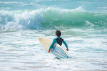 Surfer With Surfboard At The B...