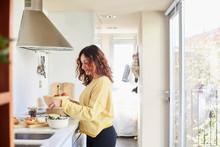Woman Making A Salad At Home
