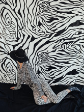 Anonymous Stylish Female Looking At Zebra Wall