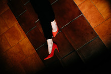 Low Section Of Man In Red Heels