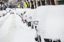 Snow-covered Street And Cars
