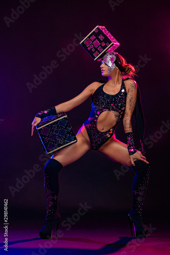 Two beautiful go-go dancer girls in freak costumes on disco in color smoke. Night show women on Halloween party. - 298141462