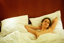 Young Topless Woman On The Bed