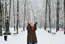 The Woman In A Snowy Park