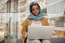 Portrait Of African Businesswoman Wearing Headscarf