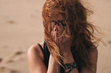Woman Crying On Windy Day In D...