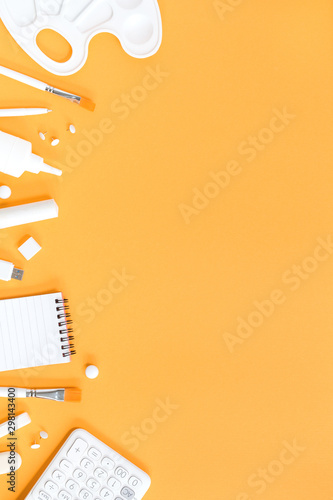 Assorted office and school white stationery on  trendy saffron orange background monochromatic with copy space - 298143400