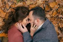 Portrait Couple Hugging In Lea...