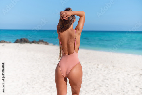 Obraz Young sexy girl in a swimsuit on the island - fototapety do salonu