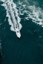 Aerial View Of Boat Moving In Sea