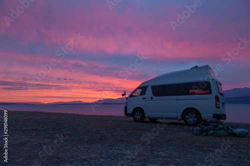 Fotografie, Tablou A campervan is standing at Lake Tekapo, New Zealand, looking into the sunset
