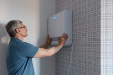 Man Installing Modern Air Cond...