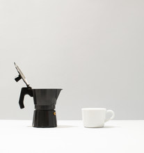 Coffeepot And A Cup