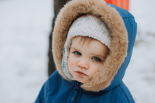 Cute Baby In Snow With Tear On...