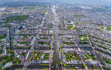Aerial View Of Canals Crossing The City Of Amsterdam, Netherlands.