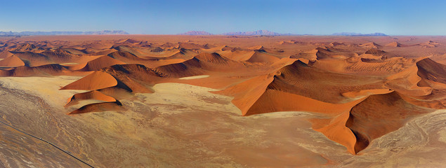 Aerial view of endless Namibia desert during daylight.