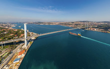 Aerial View Of A Shipping Boat Crossing Under Bosphorus Bridge, Istanbul, Turkey