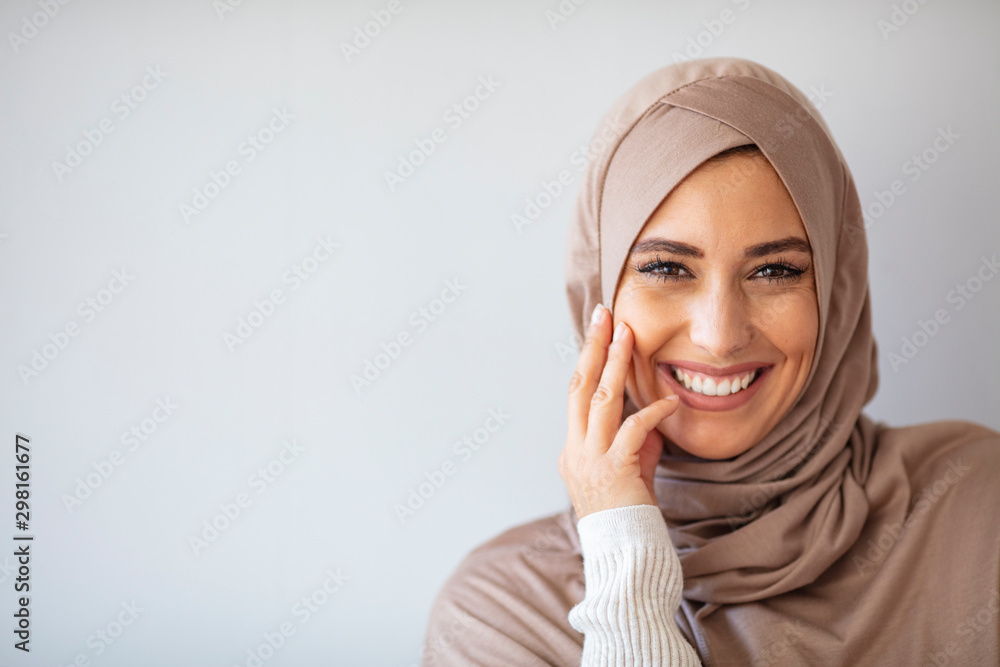 Fototapety, obrazy: Young asian muslim woman in head scarf smile. Beautiful middle eastern woman wearing abaya. Arabian woman with happy smile. Strict formal outfit and elegant appearance. Islamic fashion.