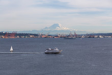 Downtown Seattle, Washington, United States Of America. Aerial View Of A Ferry Boat With Mt Rainier In The Background.