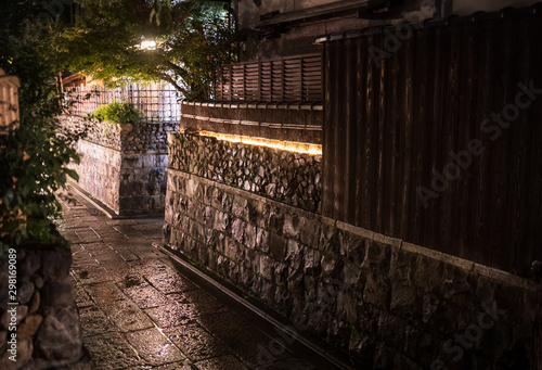 Wall Murals Narrow alley Narrow stone street through traditional Japanese neighborhood