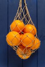 Oranges In A Net Bag Of Jute Rope