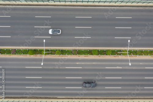 Aerial shot of two cars on opposite directions on a city highway Canvas-taulu