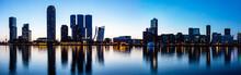 Rotterdam Netherlands Skyline Night Panorama. City Towers Illuminated, Reflections On The Water, Sunset Time