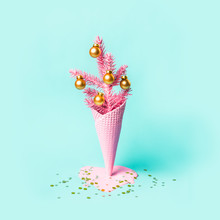 Painted Pink Ice Cream Cone With Christmas Tree And Golden Balls. Minimal Holiday Concept. Modern Greeting Card