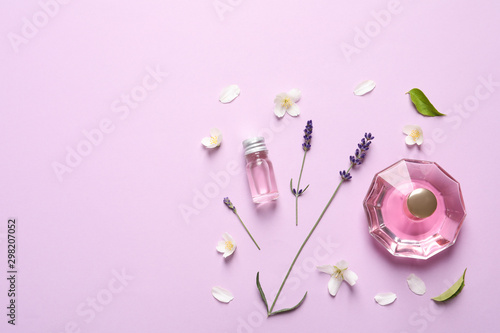 Fototapeta Flat lay composition with elegant perfume on lilac background, space for text obraz