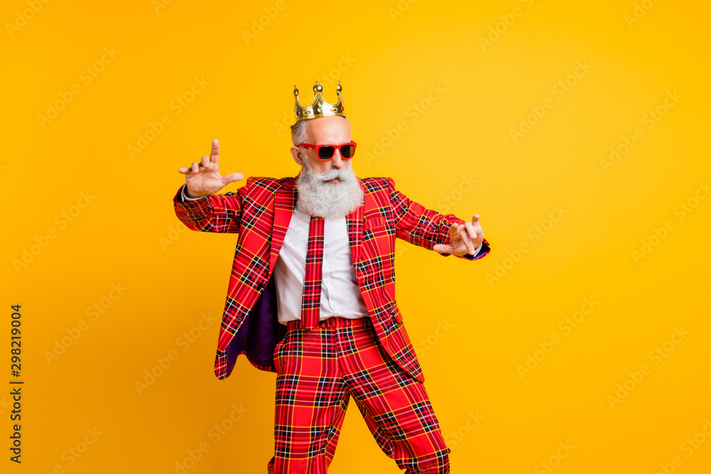 Fototapeta Photo of cool modern look grandpa white beard dancing king hip-hop strange moves wear crown sun specs plaid red blazer tie trousers outfit isolated yellow color background