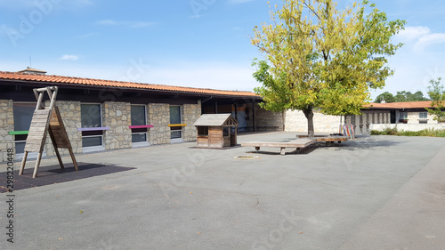Preschool building schoolyards exterior with playground on sunny day Fototapete