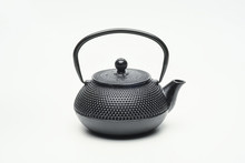 Black Cast Iron Teapot On A Wh...
