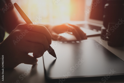 Fototapeta Graphic designer artist using graphics tablet