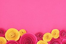 Pink And Yellow Rose Flat Lay Background With Crafted Paper Flowers At Bottom And Empty Copy Space In Middle