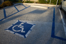 Handicapped Parking Space With Golden Hour Sunlight And Shadows
