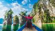 Panorama traveler man on boat joy fun amazed nature rock island adventure scenic landscape Khao Sok National park, Famous place tourist travel Thailand Tourism beautiful destination Asia vacation trip